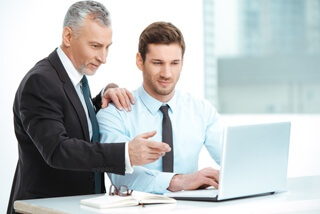 An employee is learning from a SCORM training program.